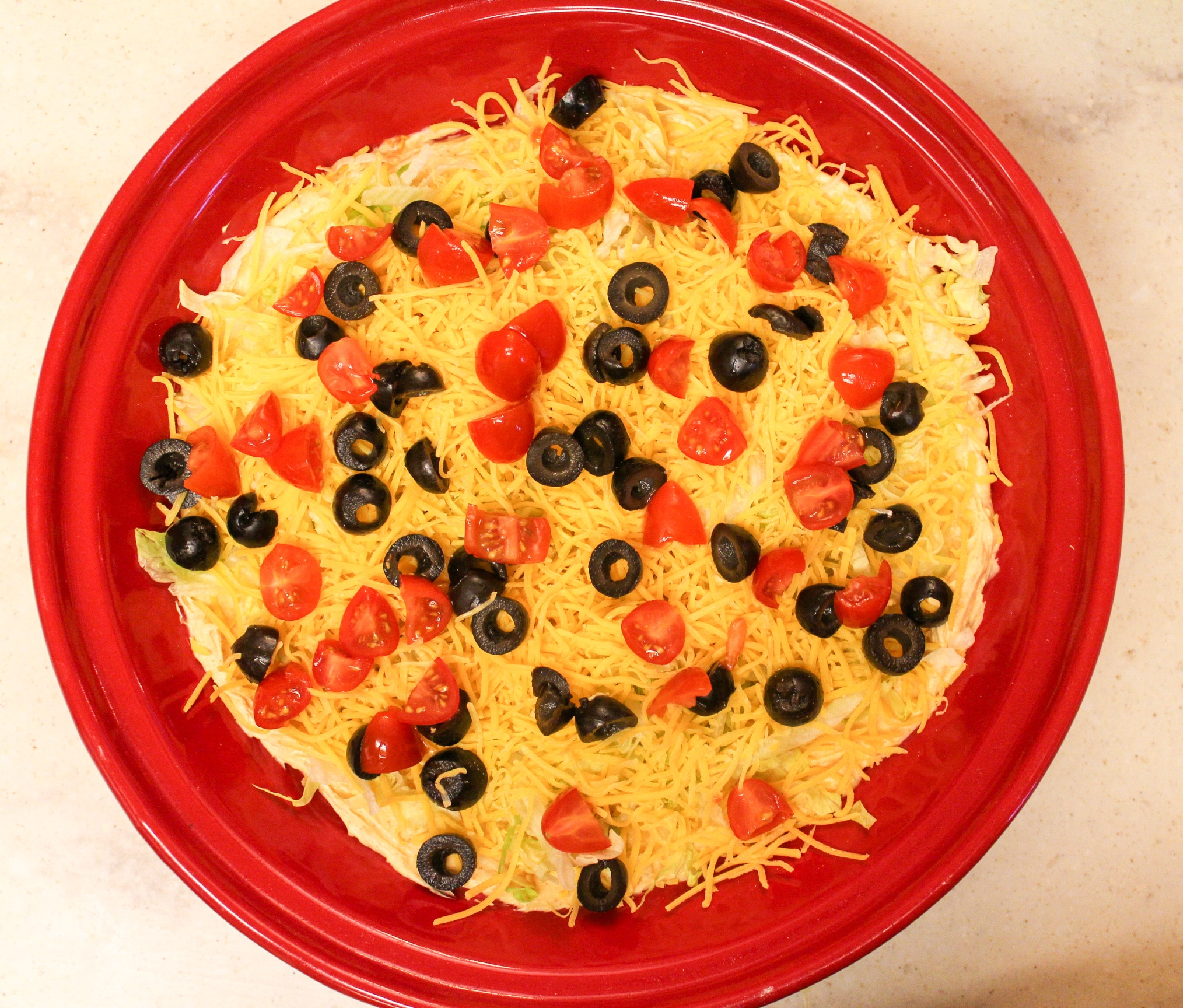 taco dip overhead shot in red plate