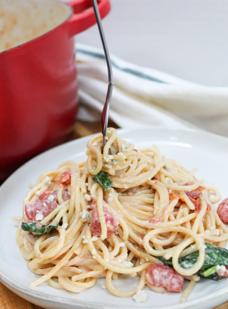blue cheese and tomato pasta with fork