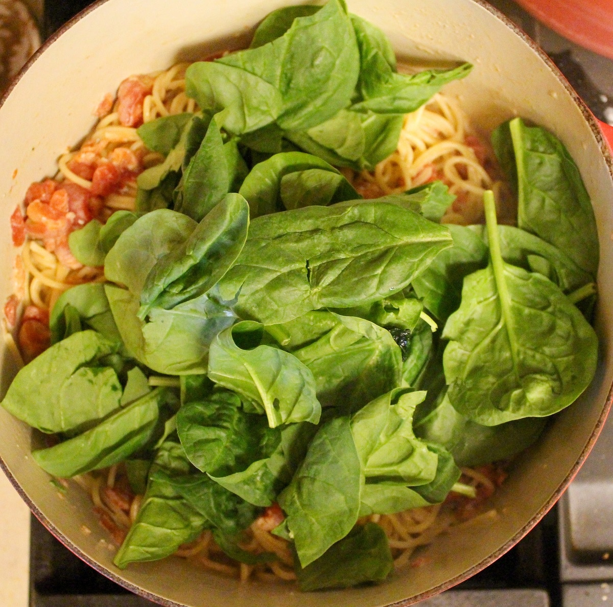 pasta in a pot with spinach