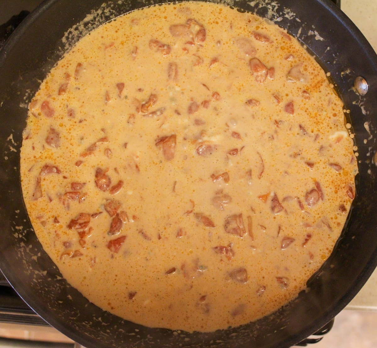 creamy tomato blue cheese sauce in skillet