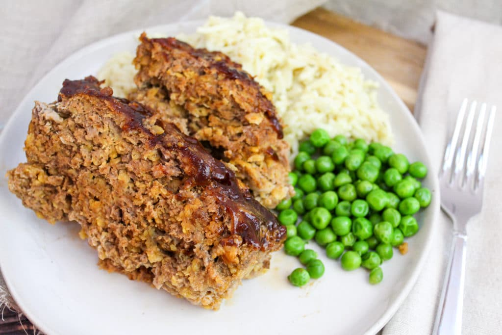 sliced meatloaf on a white plate