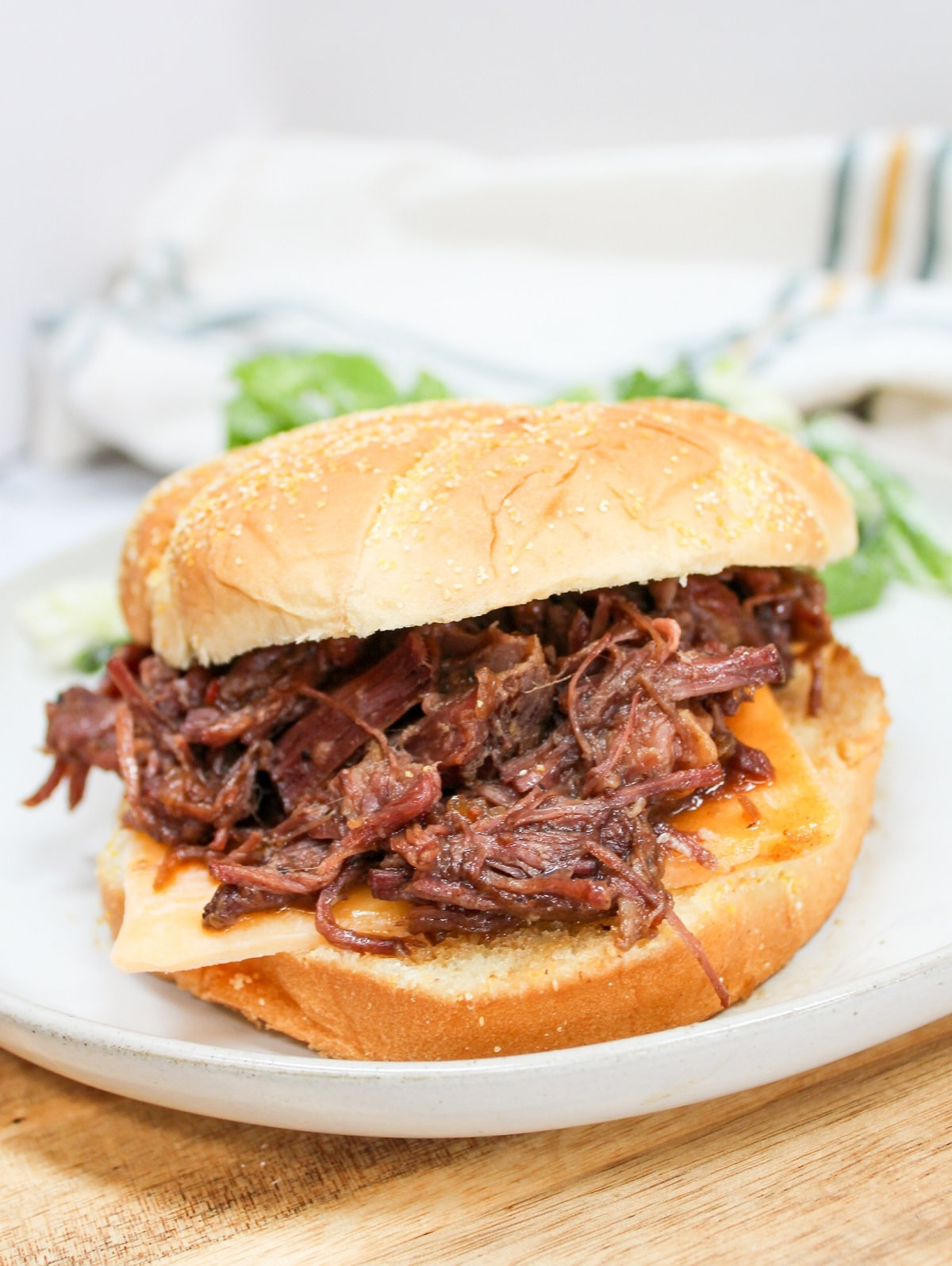 slow cooker hot beef sandwich on a white plate