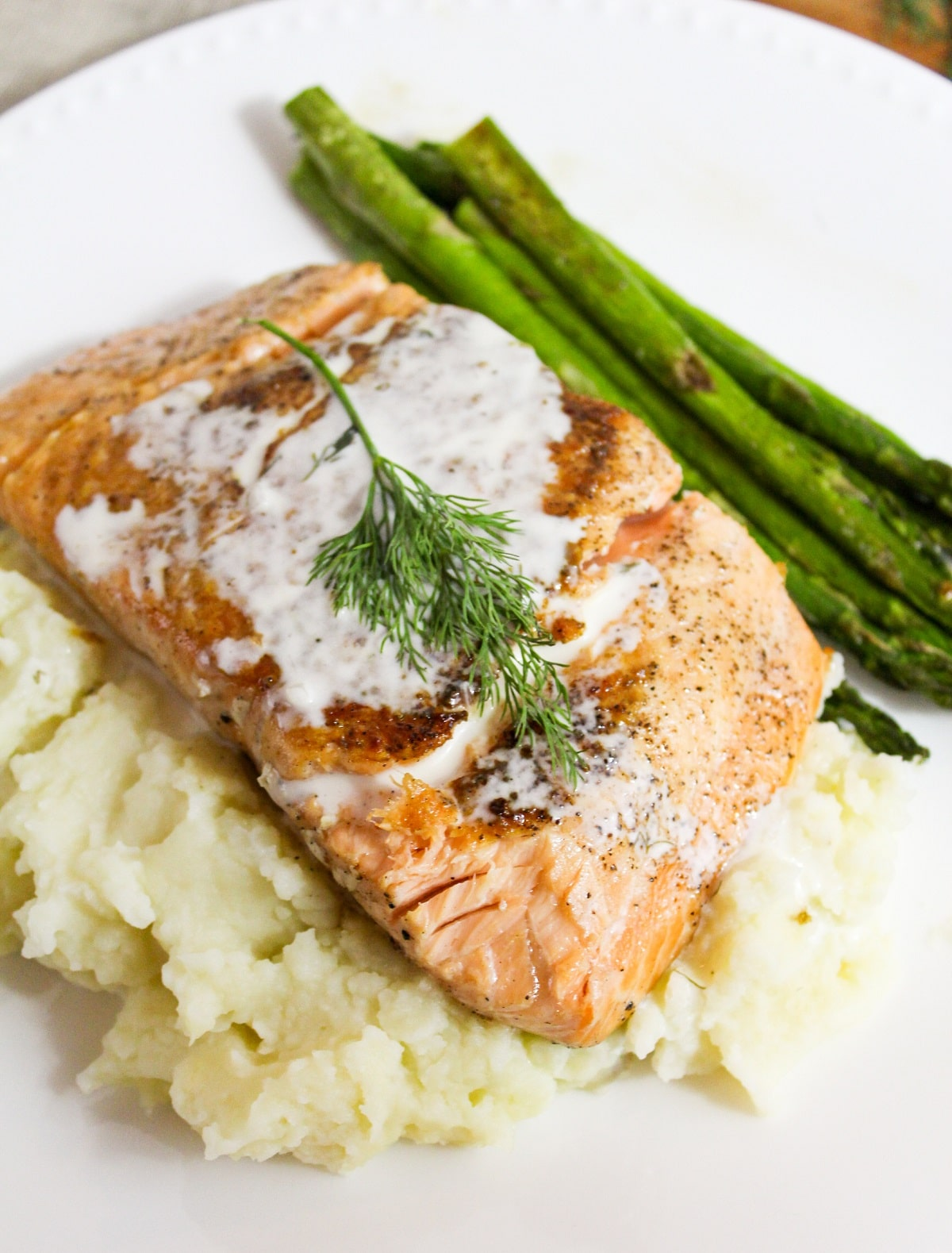 salmon with champagne sauce and dill on top