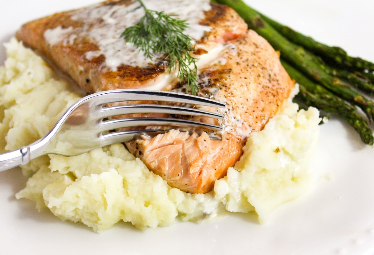 salmon cut with a fork