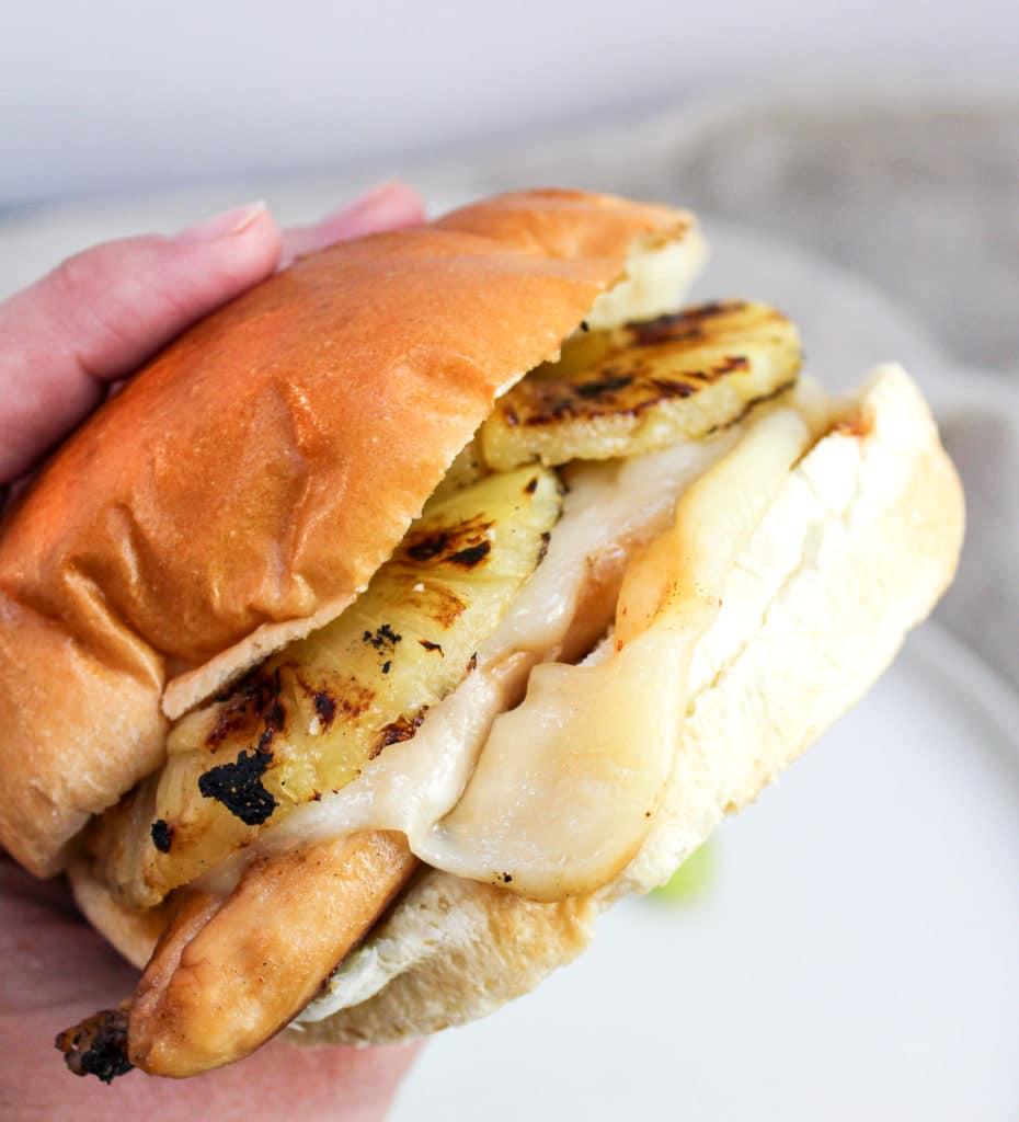 chicken sandwich held in hand