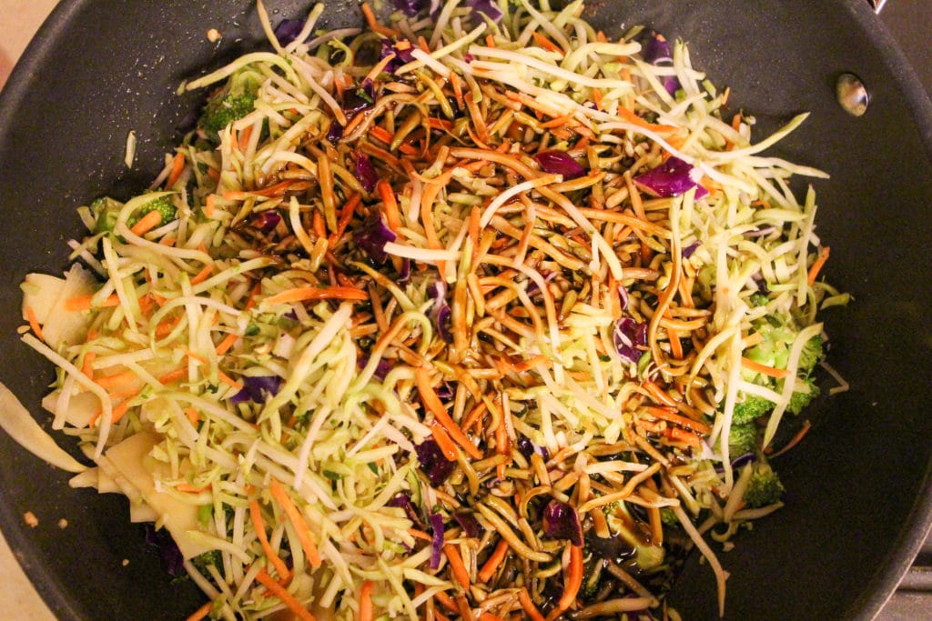 broccoli slaw and sauce in pan