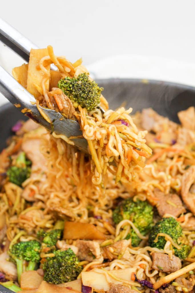 pork stir fry with tongs