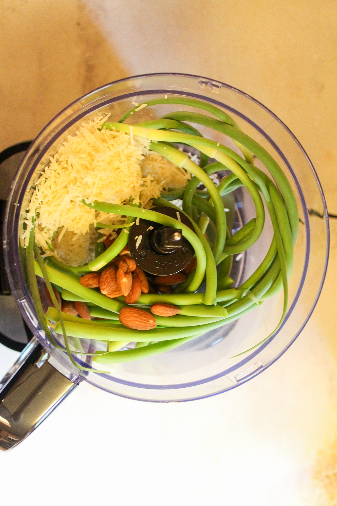 scapes and almonds in food processor