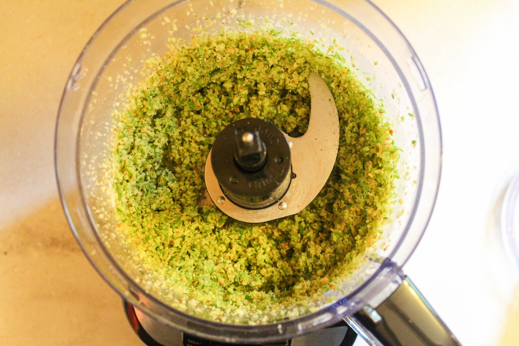 scapes and almonds in food processor blended
