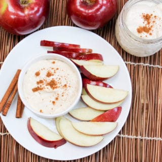 apple cider dip in a bowl with sliced apples