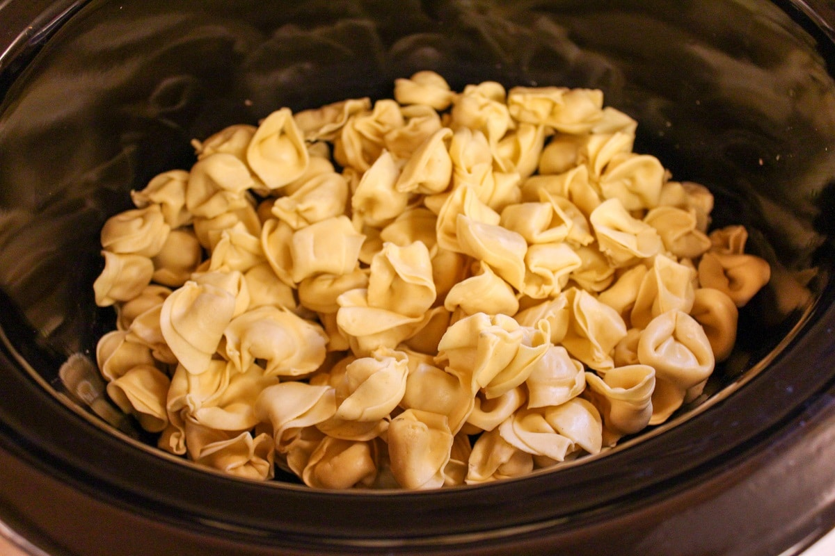 uncooked tortellini in slow cooker