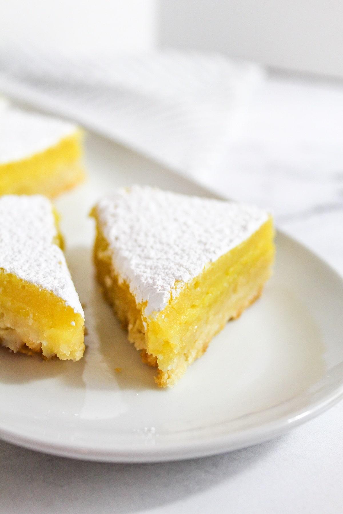 meyer lemon bars on a plate