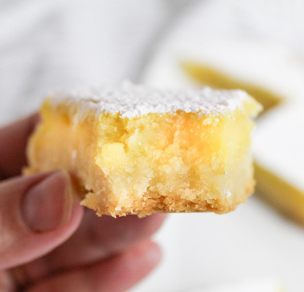 meyer lemon bar with a bite