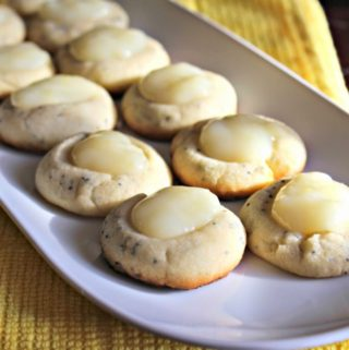 cookies with lemon curd on a white plate