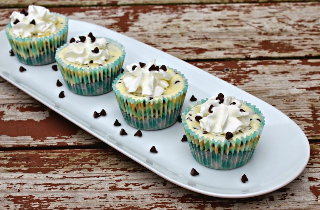 mini cheesecakes topped with chocolate chips on a plate