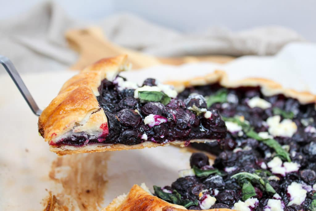 blueberry galette lifted slice from cutting board