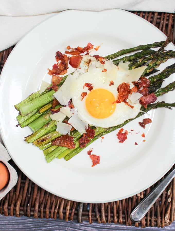 overhead shot of egg and asparagus salad on a plate