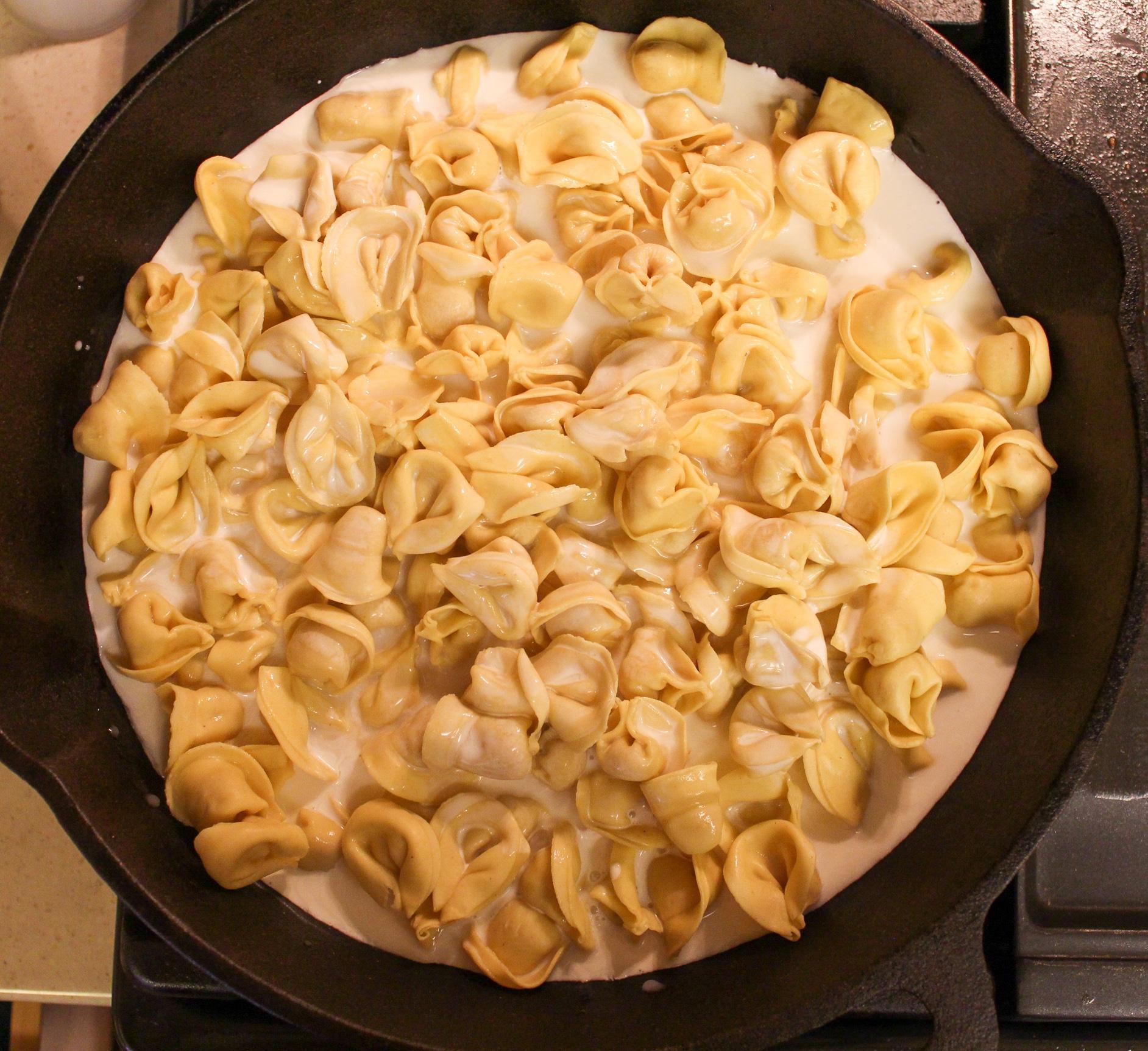 pasta in skillet with milk