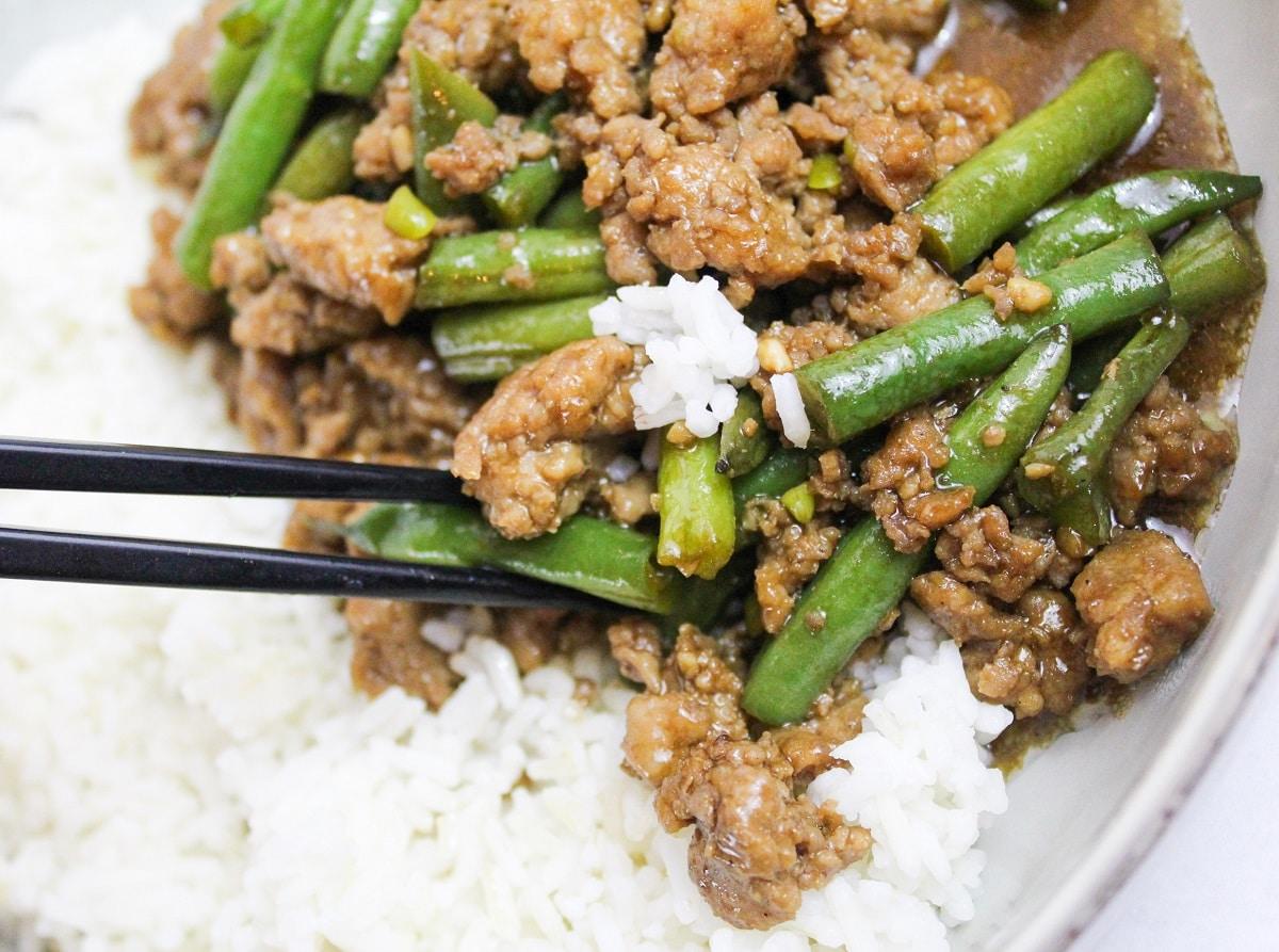Szechuan Green Beans and Ground Pork on chopsticks