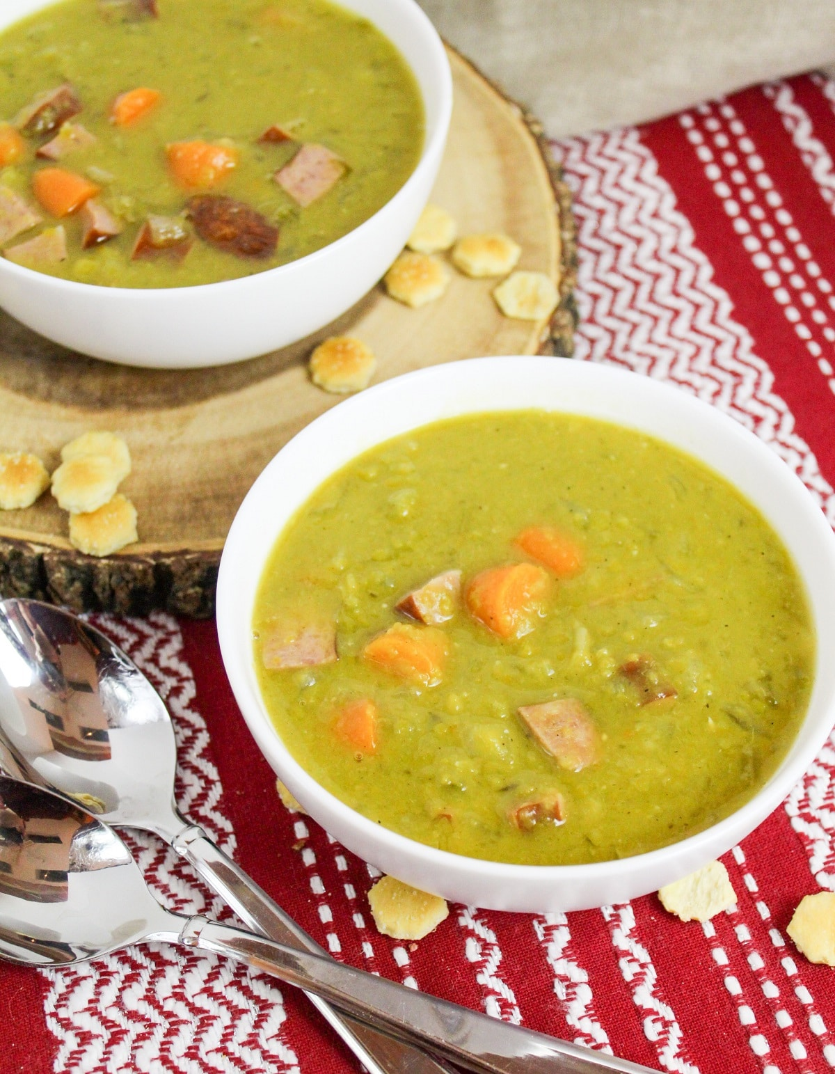 split pea and kielbasa soup in a white bowl