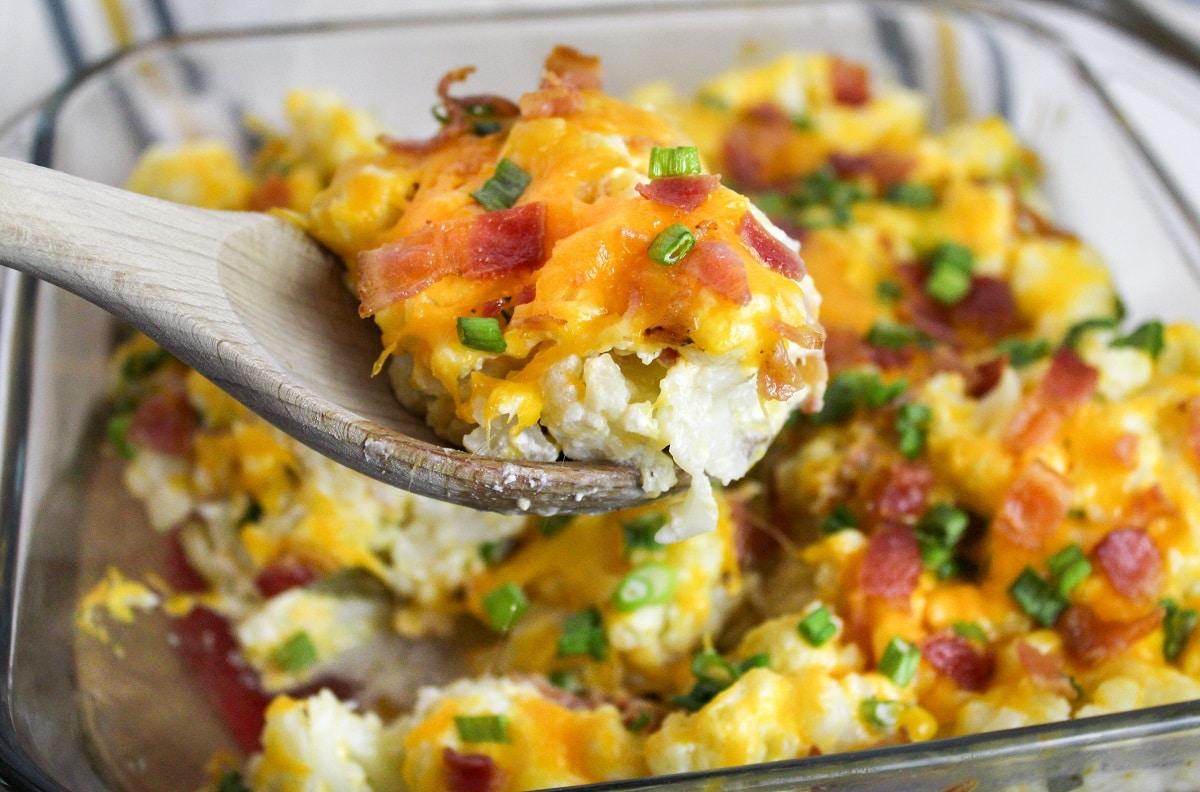 loaded cauliflower casserole on a spoon