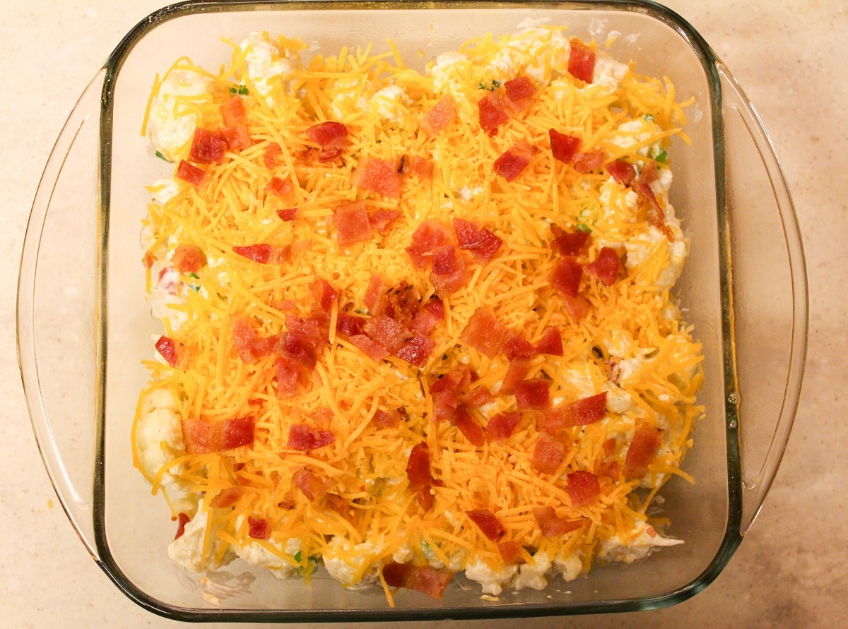 Casserole in a glass baking dish with bacon