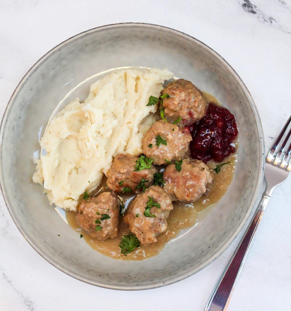 overhead photo of slow cooker Swedish meatballs