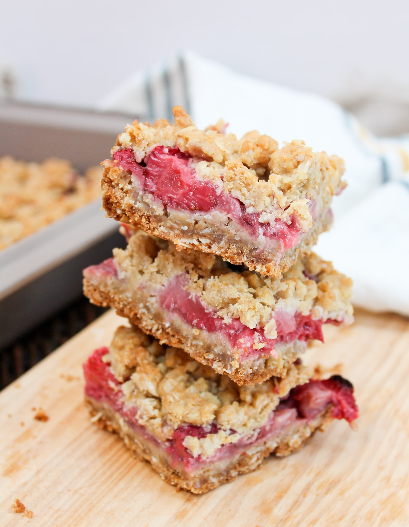 Strawberry Crumb Bars cut in squares and stacked