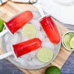 Popsicle over ice with limes