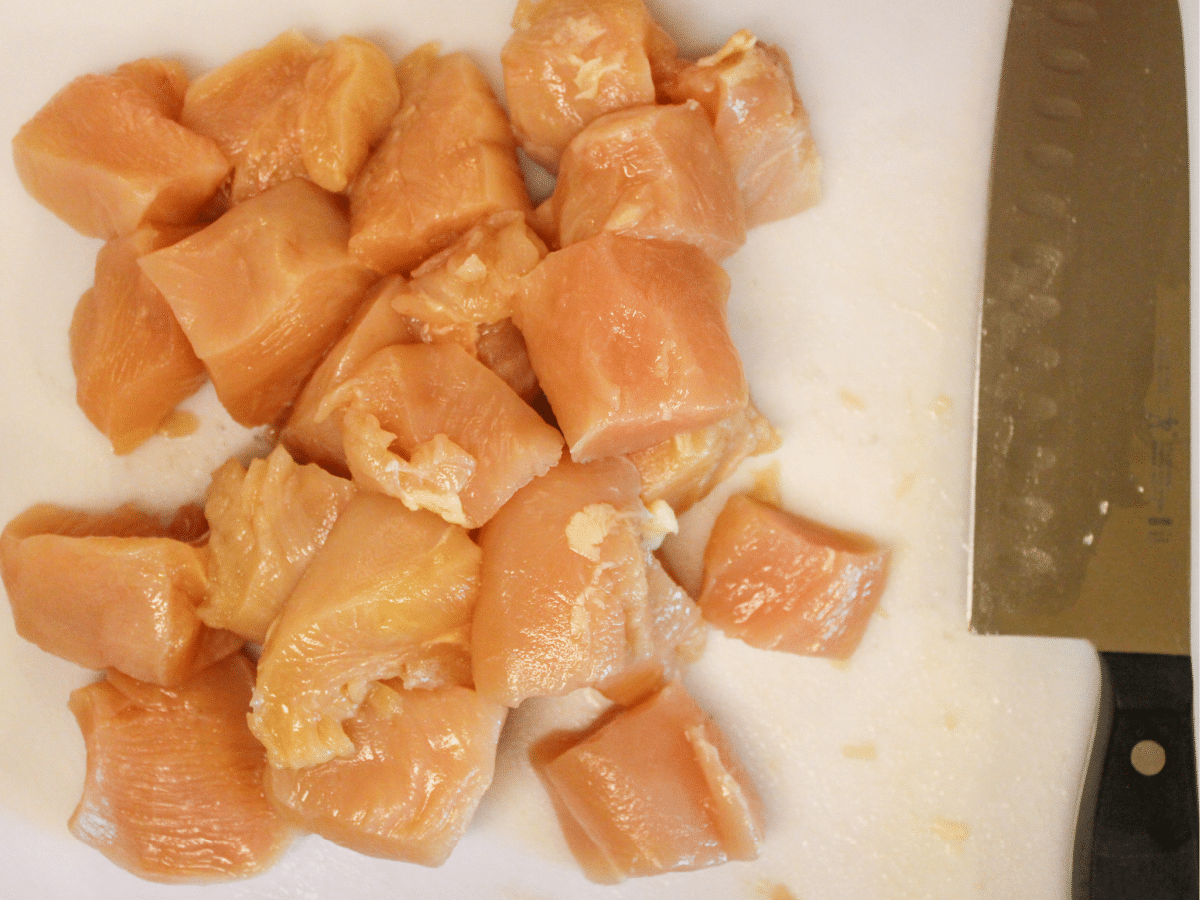 pieces of cut chicken on a cutting board