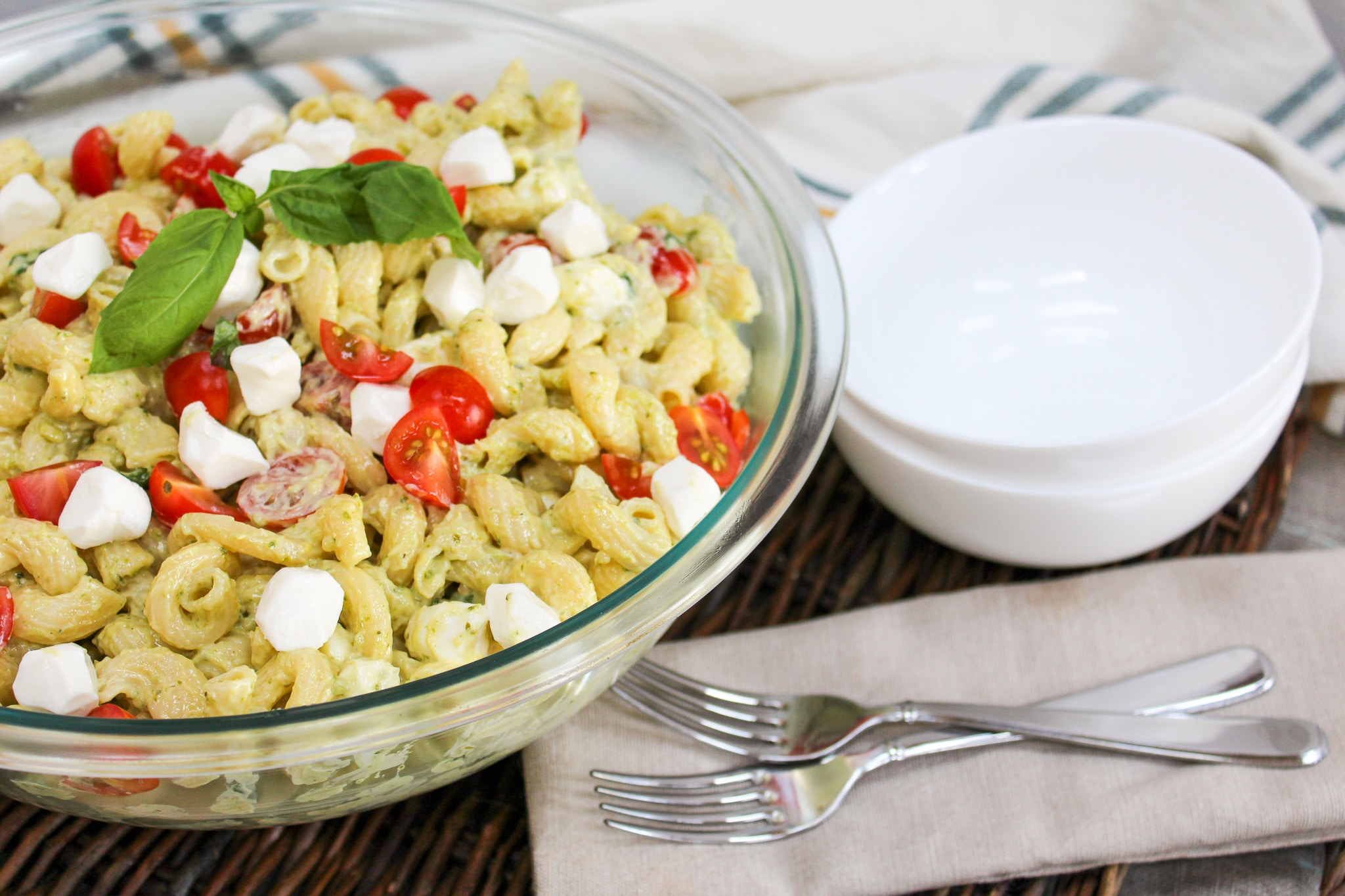 pasta salad plated in a glass bowl