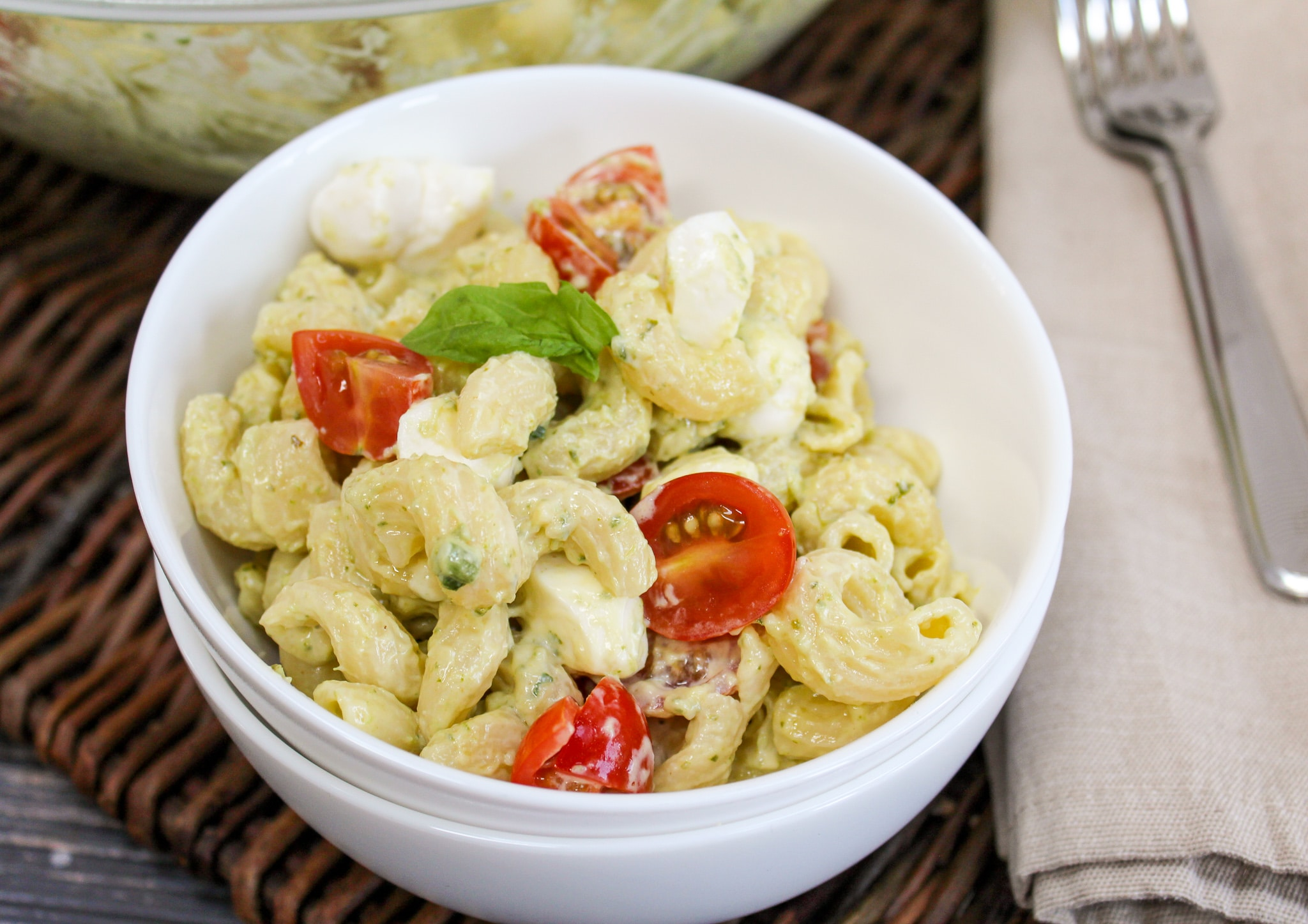 pasta salad in white individual bowls