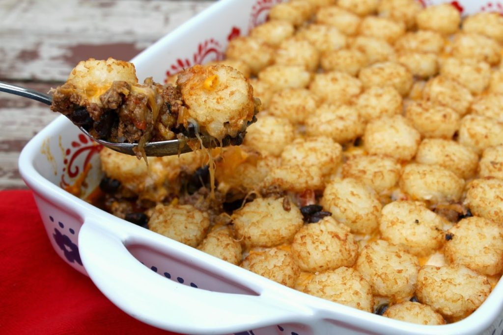 Ground beef and potato crowns scooped from a casserole dish