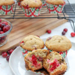 Several Muffins on a plate and on cooling wrack