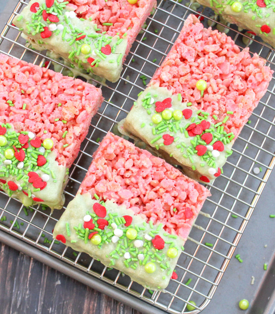 rice krispie treat squares dipped in white chocolate and sprinkles