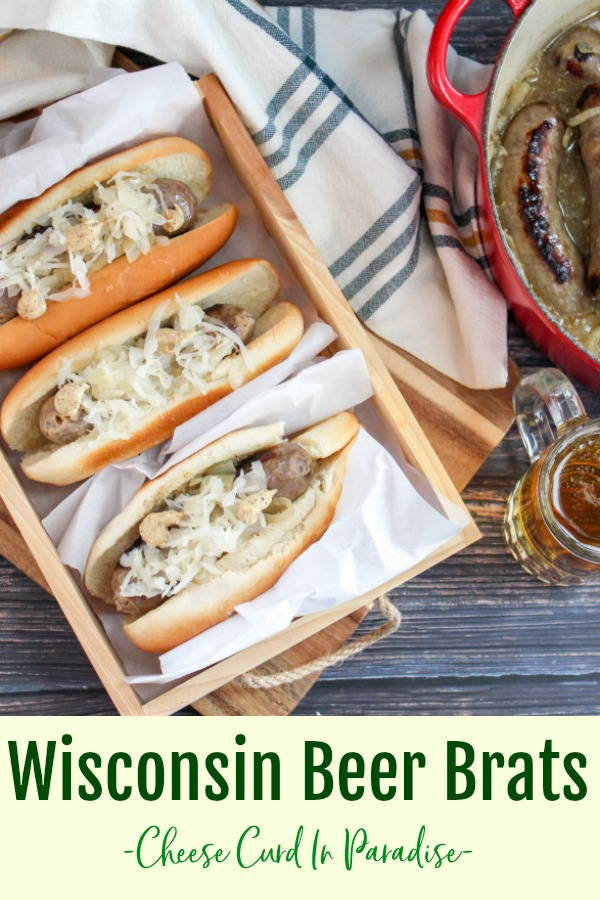 brats in buns on a wood platter