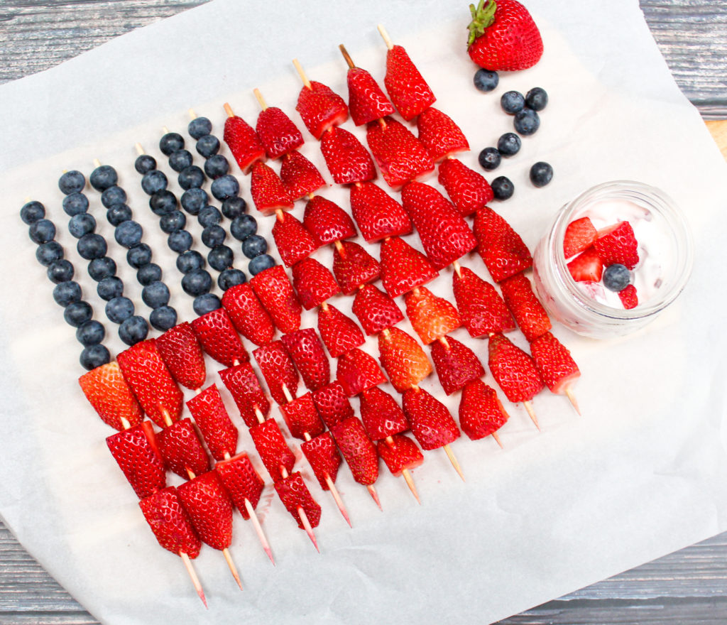 fruit kabobs on a tray