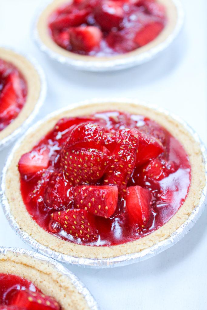 mini strawberry pies on a platter