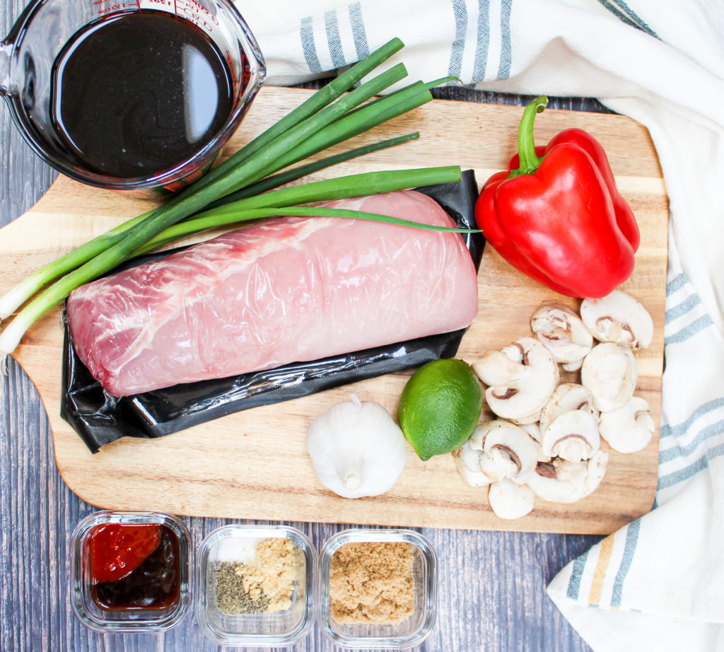 pork on a cutting board with ingredients