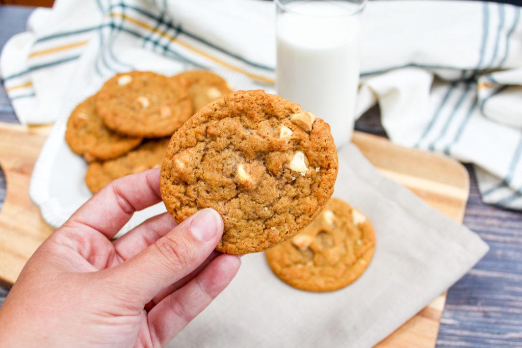 pumpkin cookies held in hand