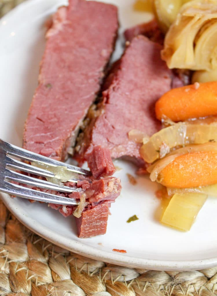 corned beef on a plate with a fork