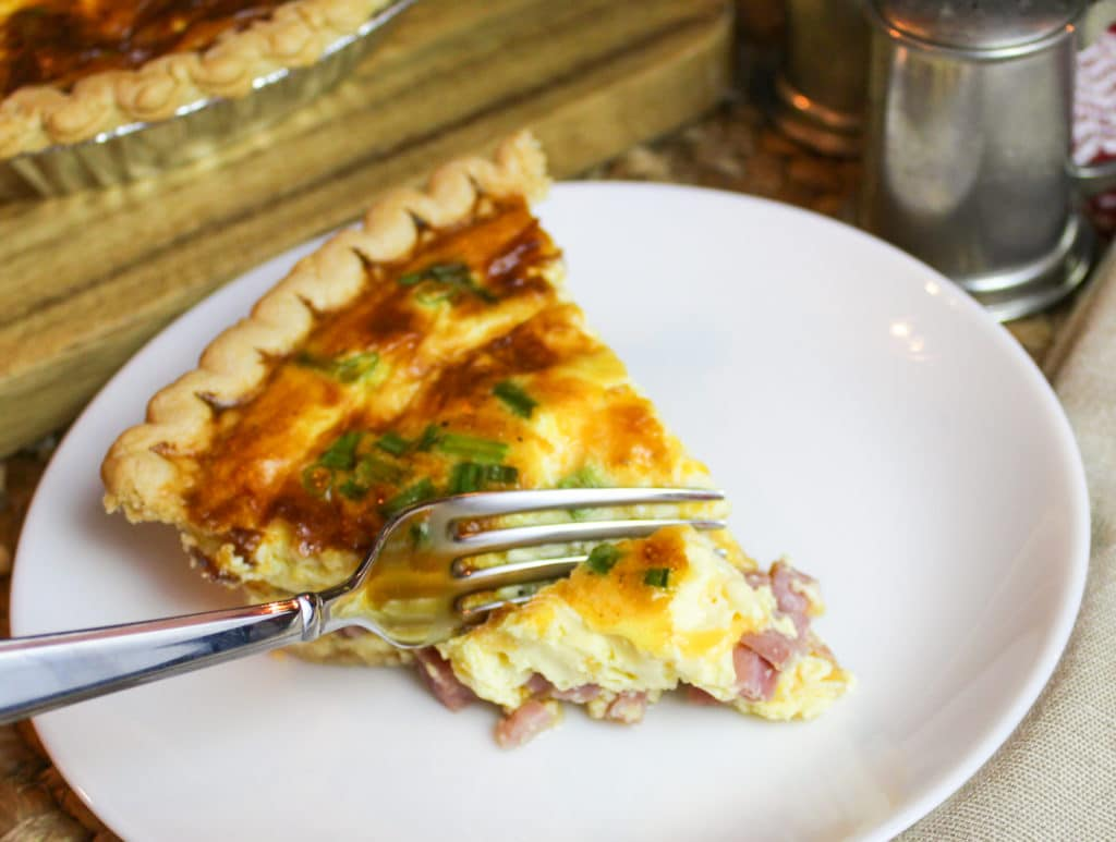 Ham and Cheese Quiche on a plate with a fork