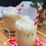 Eggnog white Russian in a glass with whipped cream