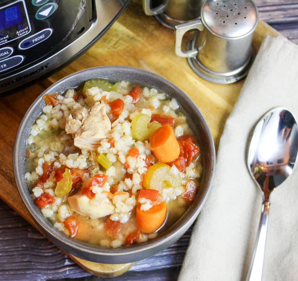 soup in a bowl next to the slow cooker