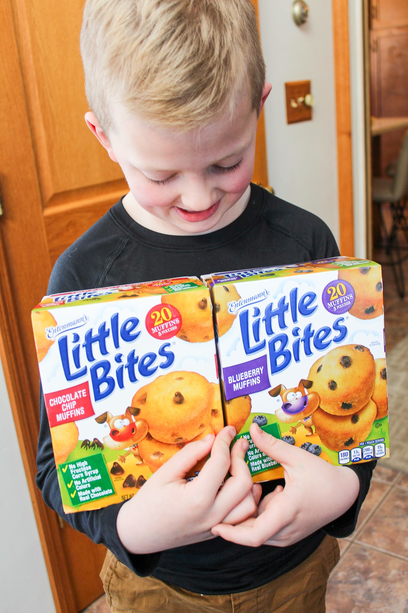 child with box of muffins