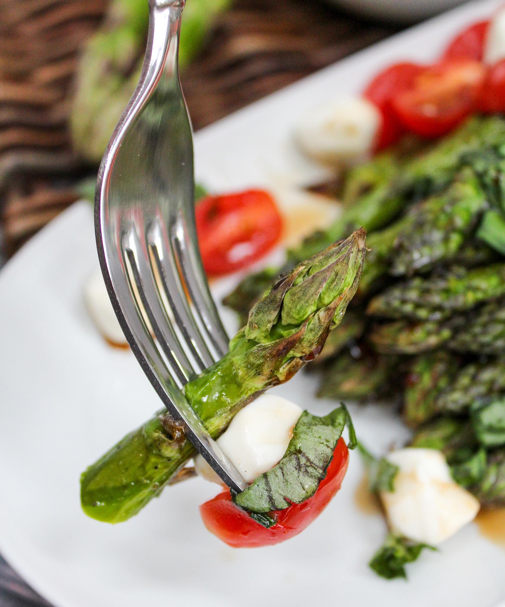 Grilled Asparagus Caprese Salad on a fork