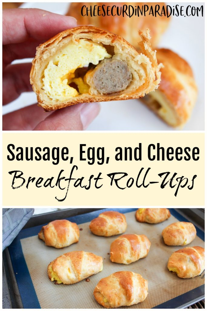 roll-up cut in half to see eggs and sausage and held in hand
