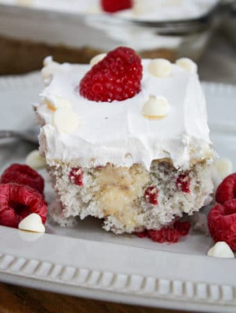 straight view of Raspberry White Chocolate Poke Cake