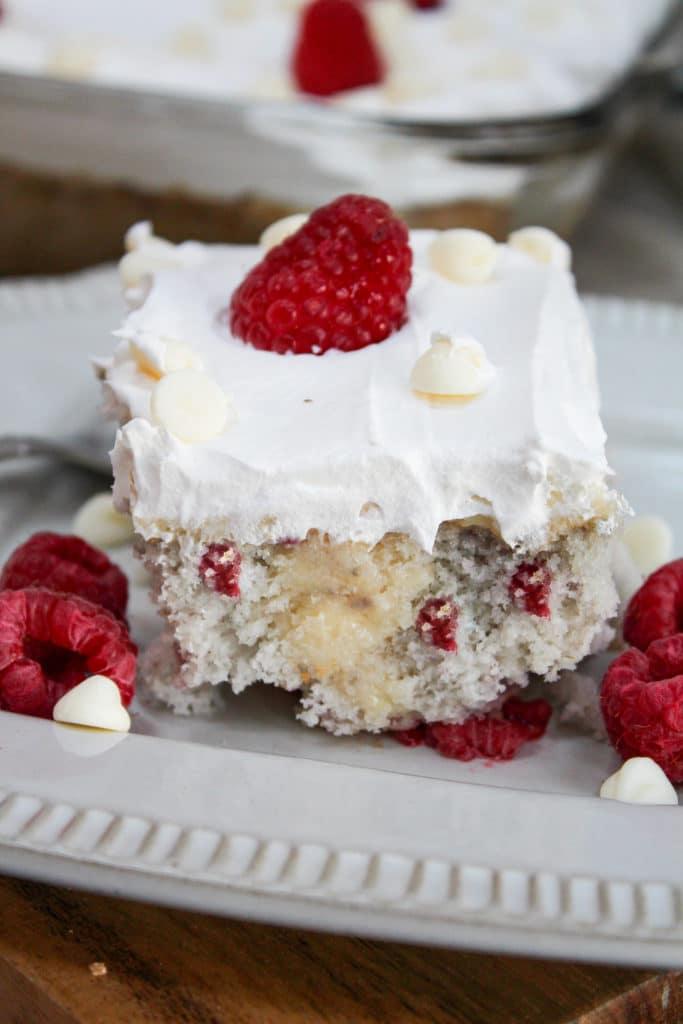 straight view of Raspberry White Chocolate Poke Cake