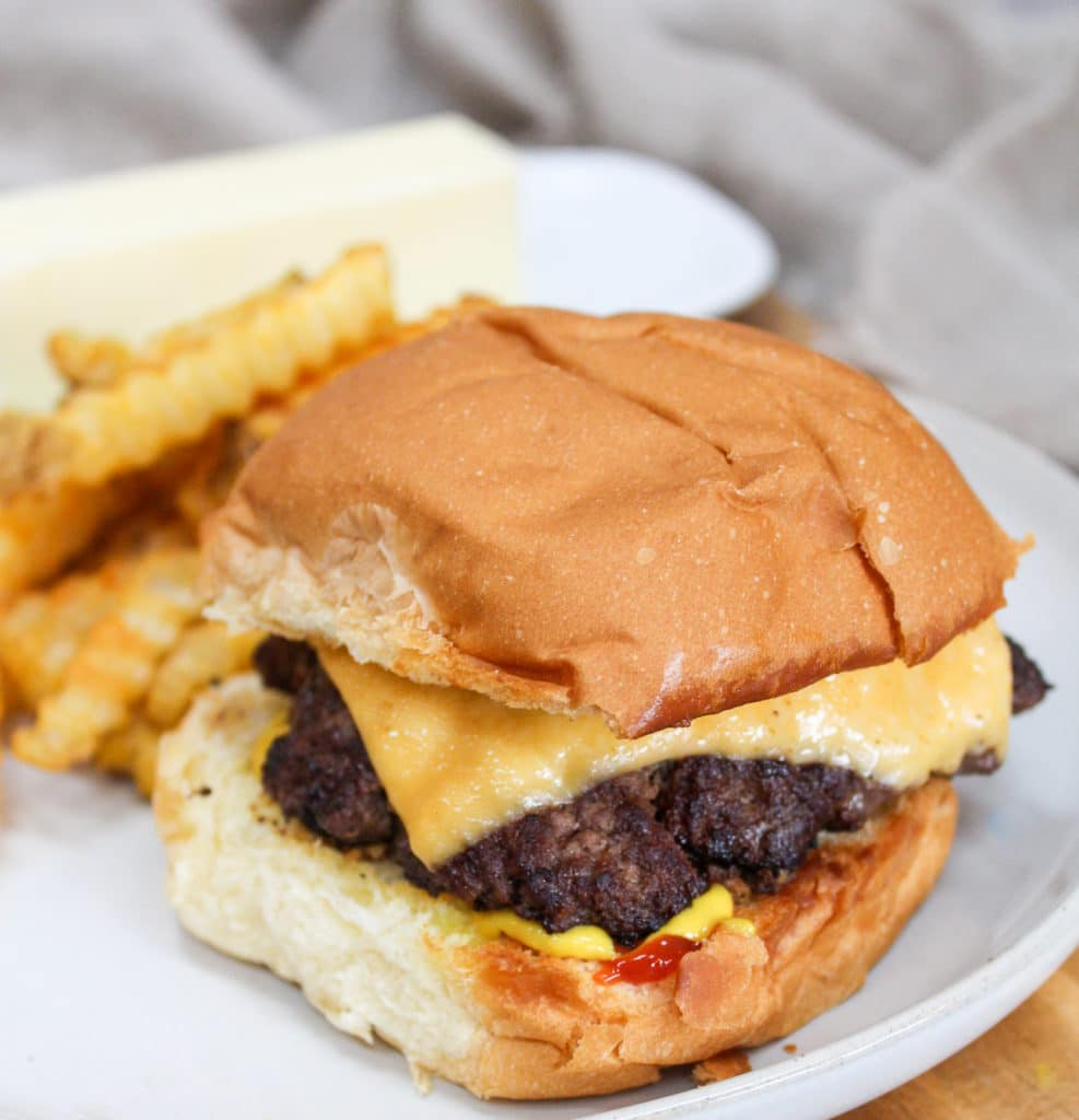burger on a plate with fries